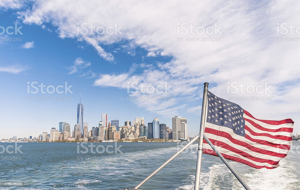 New York - Manhattan skyline and American Flag stock photo