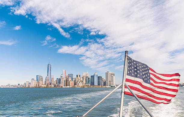 New York - Manhattan skyline and American Flag stock photo