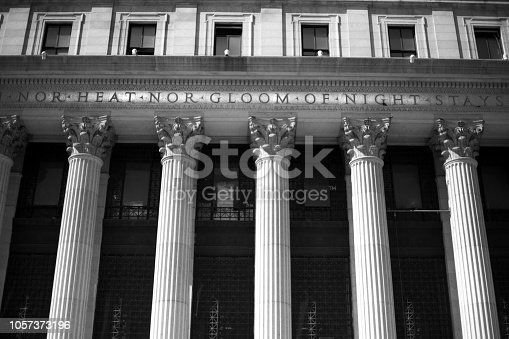 New York, NY: The old Farley Post Office, built in 1912 will be the new Moynihan Station, an extension of Penn Station, with its famous Corinthian columns and inscription. Close-up shot.