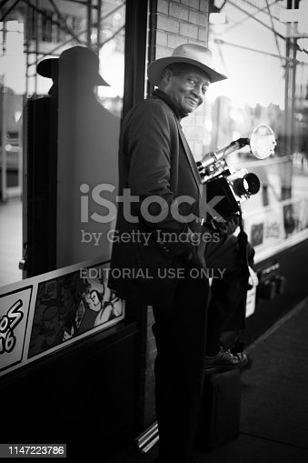 New York, NY: Photographer Louis Mendes working with a vintage camera on a sidewalk on 34th Street in midtown Manhattan.