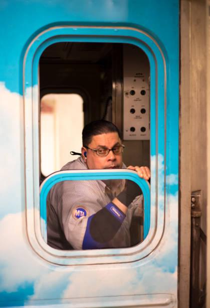 new york, ny: subway train conductor - konduktor pociągu zdjęcia i obrazy z banku zdjęć