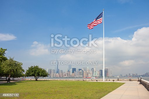 New York, Usa - June 13, 2014: New York panorama, One World Trade Center (formerly known as the Freedom Tower) and Ellis Island. Freedom Tower is shown finished with antenna.