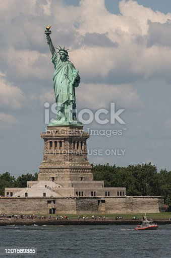 New York, USA - Jul 24, 2019: The Coast Guard patrolling the Statue of Liberty early in the day.