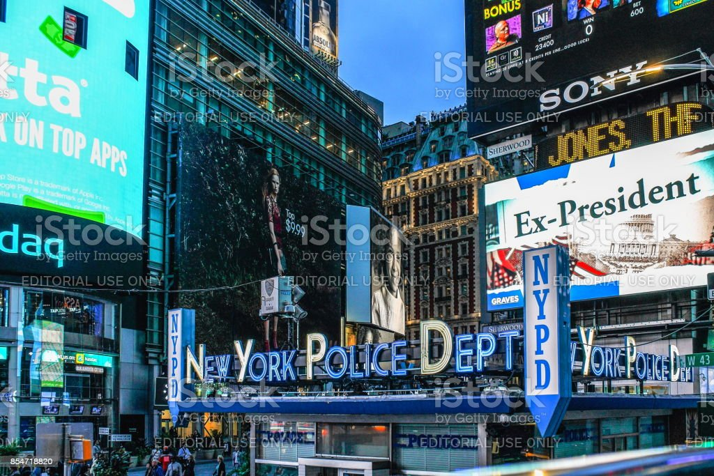 New York Police Department Times Square Precinct against Bright Lights Billboards in Manhattan. stock photo