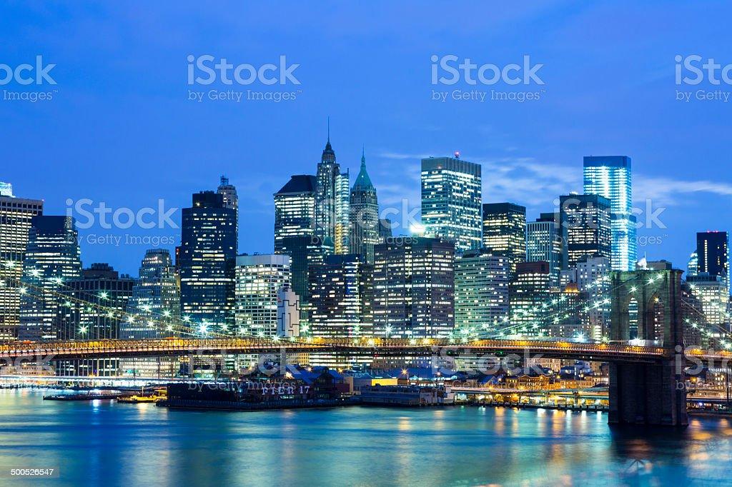 New York Skyline And Brooklyn Bridge at Night royalty-free stock photo