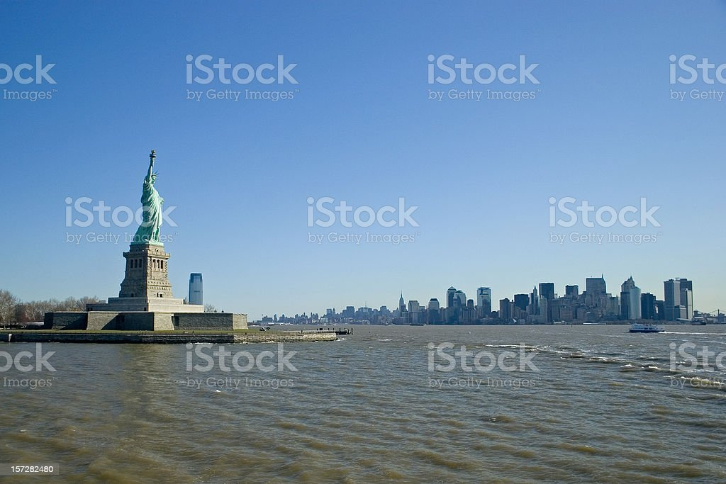 New York skyline and Miss liberty royalty-free stock photo