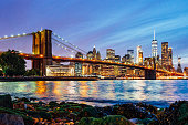 New York skyline at night with Brooklyn Bridge