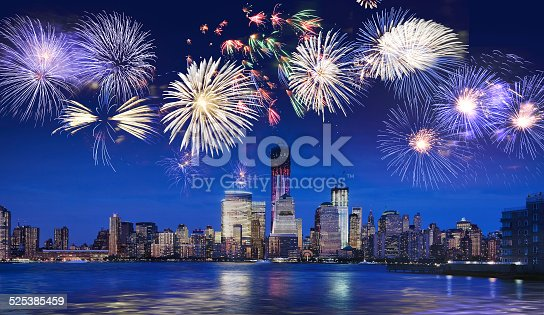 istock New York skyline at night with fireworks 525385459