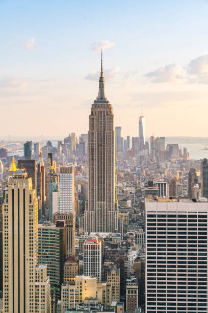 new york skyline at sunset. new york skyline at sunset. empire state building stock pictures, royalty-free photos & images