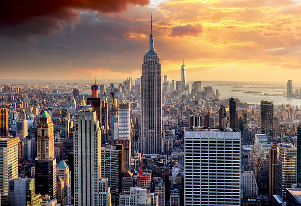 new york skyline at sunset, usa. - wall street lower manhattan stock pictures, royalty-free photos & images