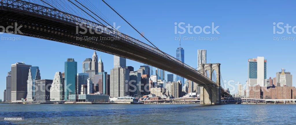 New York Skyline + Brooklyn Bridge stock photo