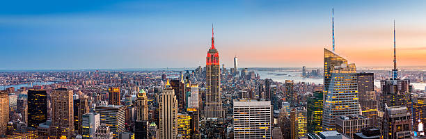 New York skyline panorama New York skyline panorama at sunset empire state building stock pictures, royalty-free photos & images