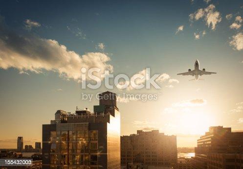 182061540 istock photo New York Skyline with airplane 155432003