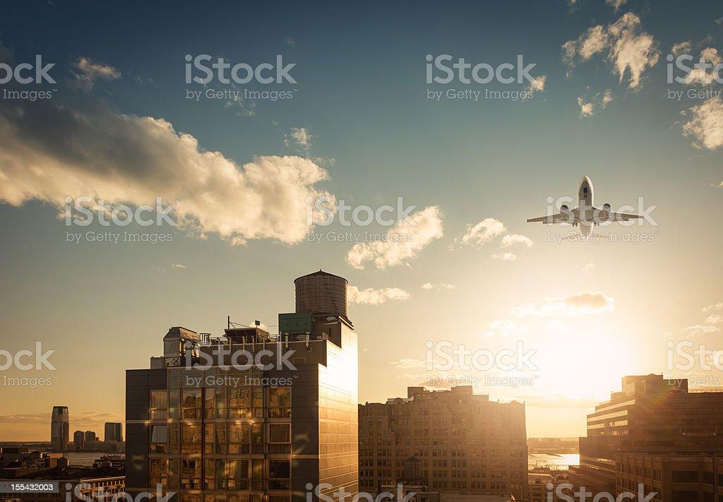 New York Skyline with airplane stock photo
