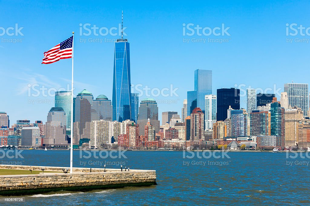 New York Skyline with Freedom Tower and USA Flag stock photo
