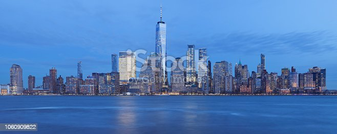 Night time view of the skyline of Lower Manhattan in New York City including the financial district and the world trade center complex. Lower Manhattan is the fourth largest business district in the United States. It is home to the New York Stock Exchange on Wall Street and the NASDAQ.