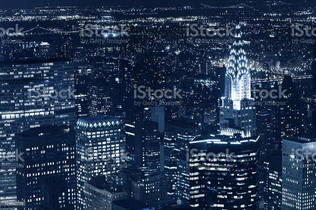 new york skyscraper and chrysler building at night stock photo