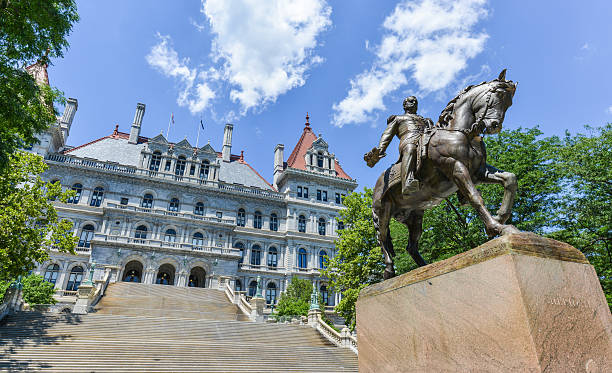 New York State Capitol Building, Albany The New York State Capitol Building in Albany, home of the New York State Assembly. Monument of General Sherman on horseback. albany county new york state stock pictures, royalty-free photos & images
