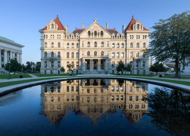 New York State Capitol in Albany Albany, New York, USA - August 5, 2018: New York State Capitol building and its reflection from West Capitol Park in Albany albany new york state stock pictures, royalty-free photos & images