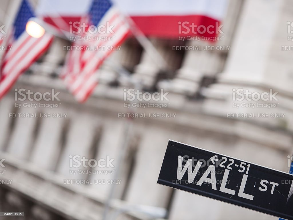New York Stock Exchange building and Wall Street sign stock photo