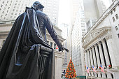 New York City, NY, USA – December 28, 2014: New York Stock Exchange Building, George Washington Statue and Christmas Tree.
