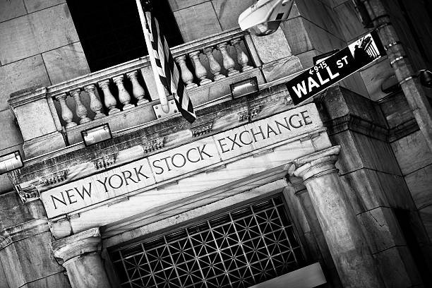 New York Stock Exchange entrance with Wall Street sign stock photo
