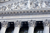 New York City, USA - December 28, 2013: Close up detail of facade at the New York Stock Exchange building located on Wall St. in Lower Manhattan.