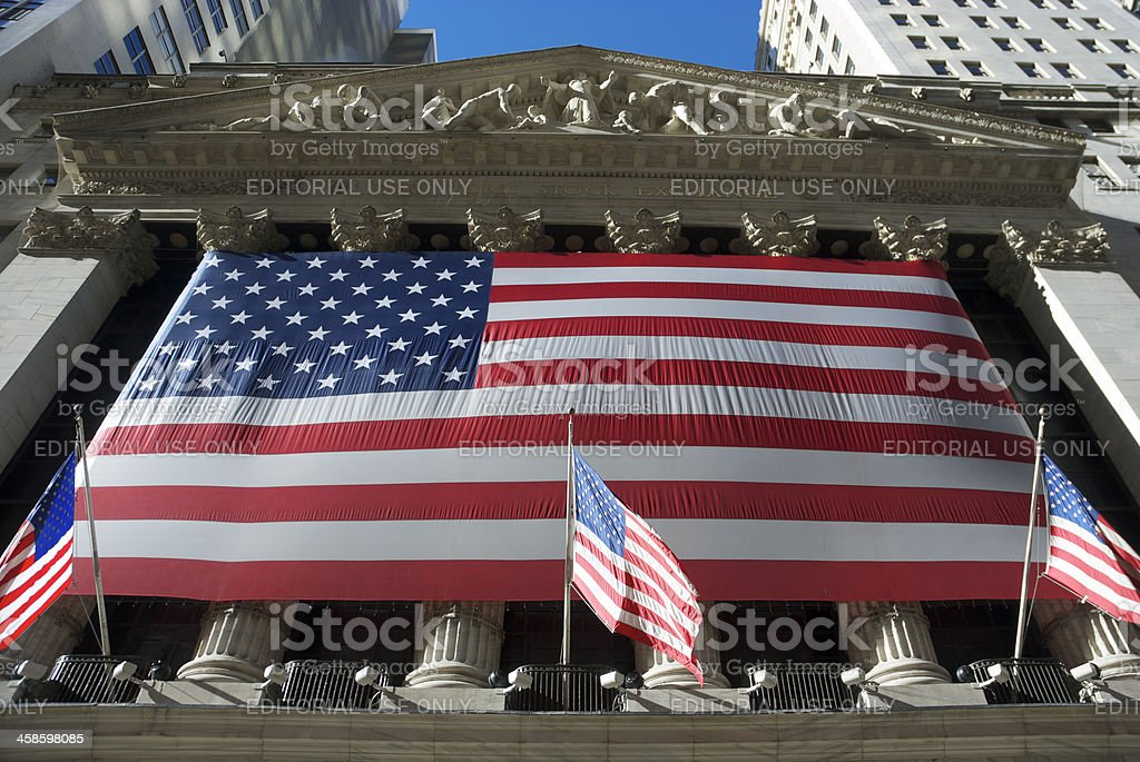 New York Stock Exchange w American Flag royalty-free stock photo