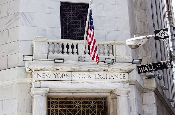 New York Stock Exchange with American flags and Wall street stock photo