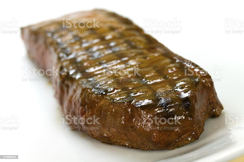 New York Strip Steak- over plate royalty-free stock photo