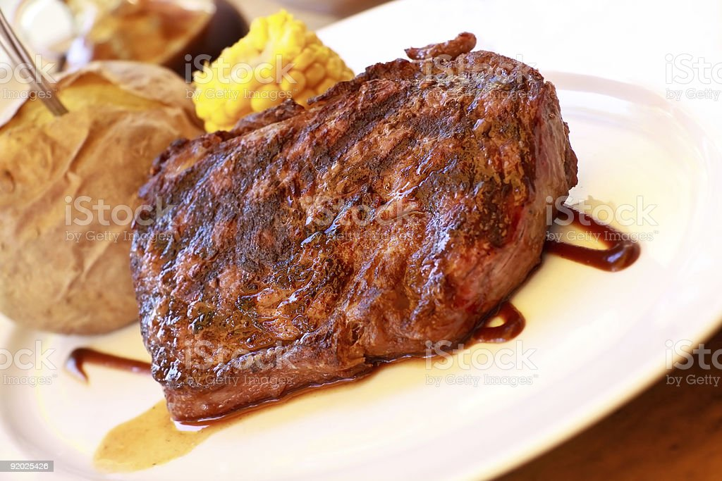 New York Strip Steak with baked Potato royalty-free stock photo