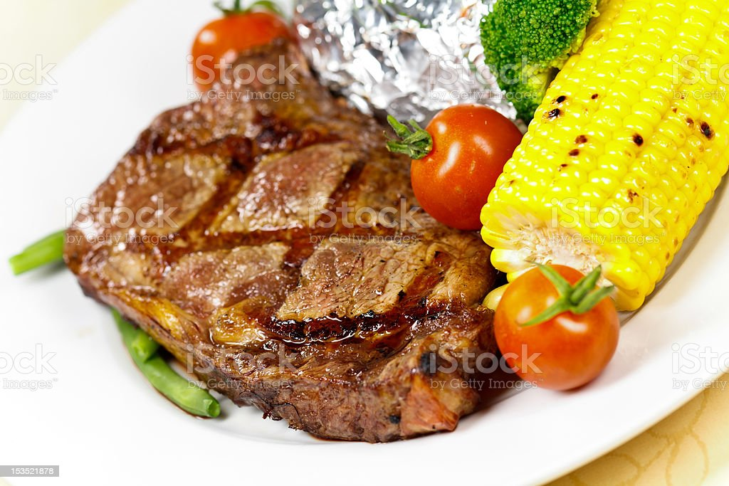 New York Strip Steak,grilled,with green Beans,Corn Cob royalty-free stock photo