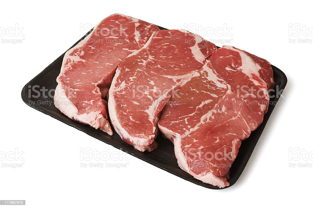 New York Strip Steaks in Tray royalty-free stock photo