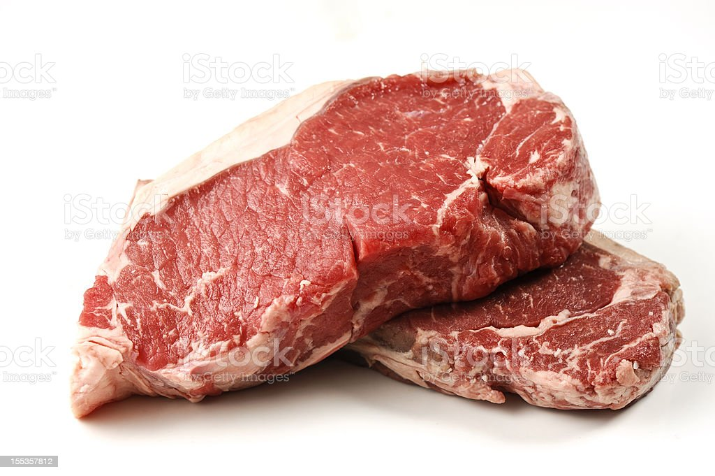 New York Strip Steaks isolated on white royalty-free stock photo