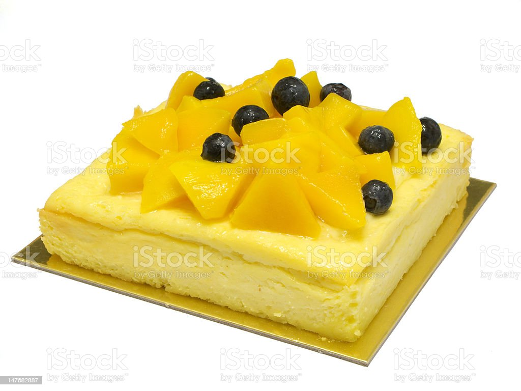 New York style cheesecake with mango and blueberries royalty-free stock photo