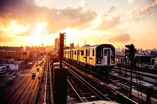 New York subway train approaching station platform in Queens