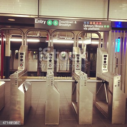 New York, New York, USA - January 4, 2013: Photo of New York City subway turnstile to access the train. This is a Fulton Street station located in Downtown Manhattan. Picture taken with mobile phone.