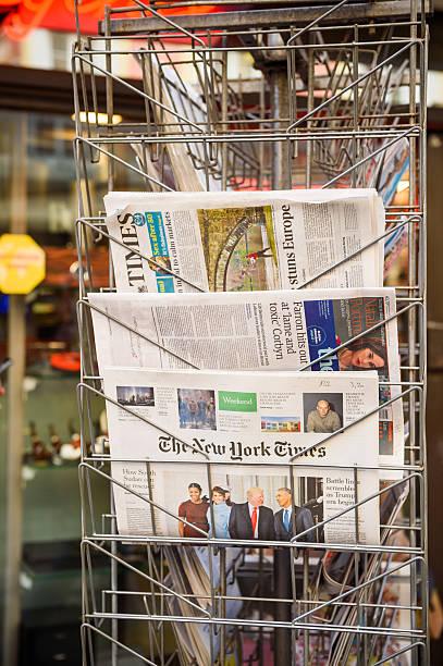 new york times, the guardian newspaper from a newsstand - donald trump us president стоковые фото и изображения