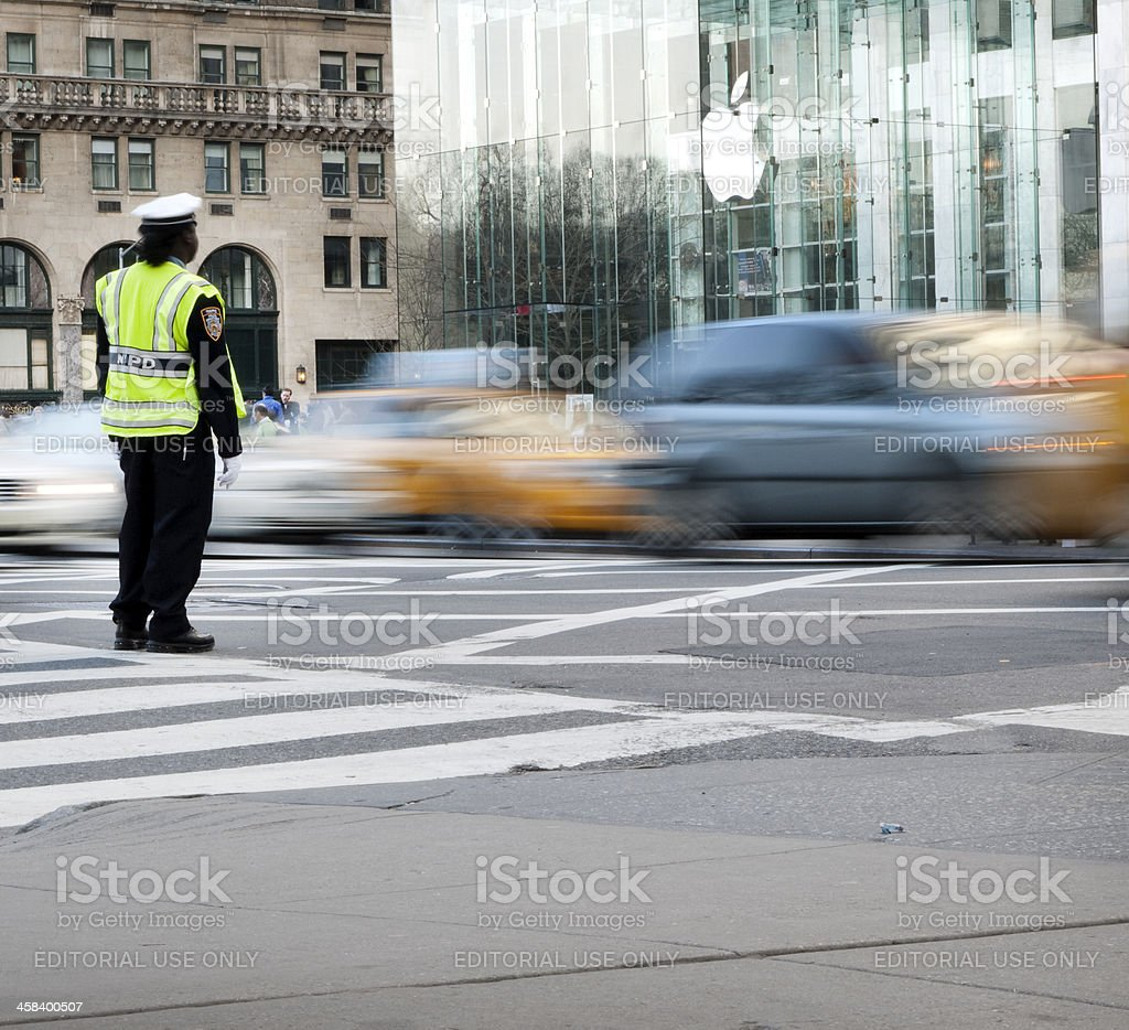 New York Traffic Cop on Fifth Avenue Near Apple Store stock photo