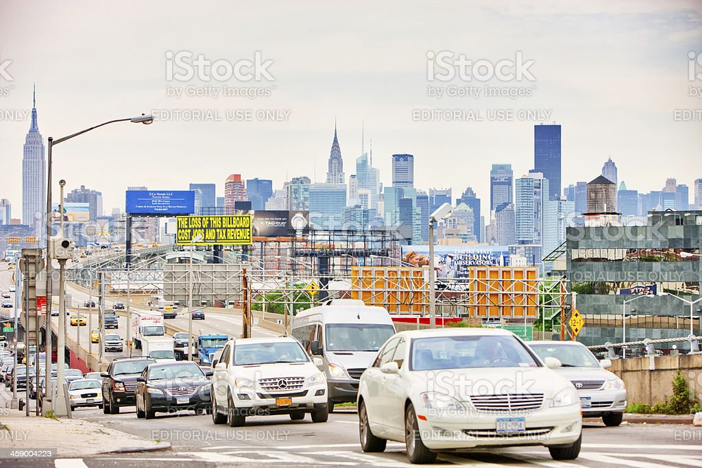 """New York Traffic """"New York, USA - May 30, 2012: Numerous cars in heavy traffic on a road from Manhattan to Queens. Famous Empire State Building and Manhattan skyline can be seen on background."""" Architecture Stock Photo"""