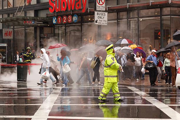 New York Traffic Policeman in Heavy Rain stock photo