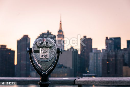 A coin-operated viewfinder pointed towards midtown Manhattan and the Empire State Building