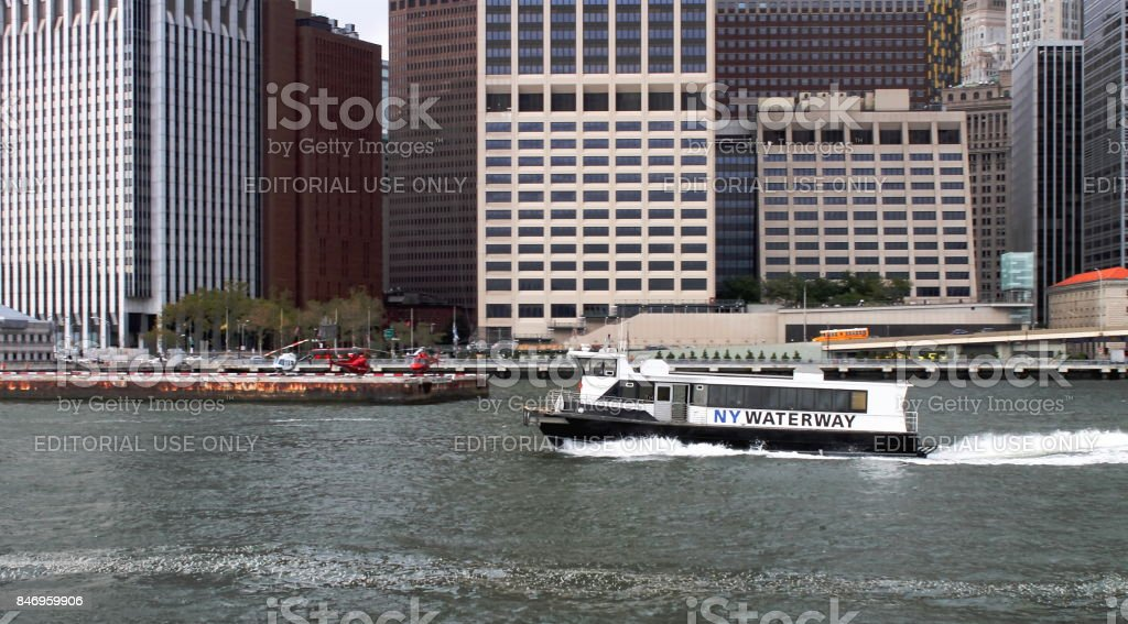 New York Waterway East River Ferry against Manhattan buildings lining the East River. stock photo