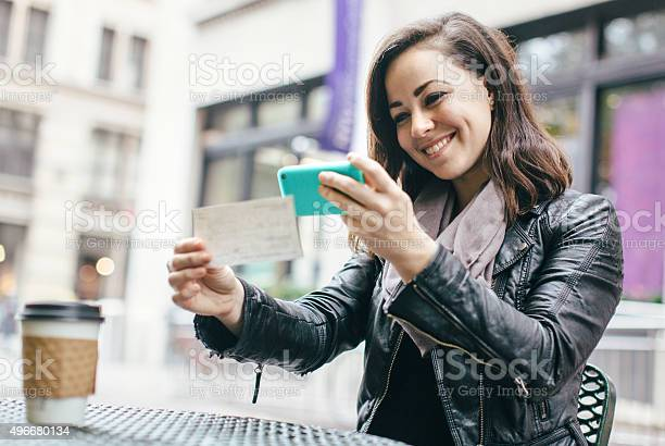 New York Woman Depositing Check Remotely Stock Photo - Download Image Now