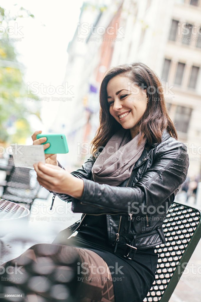 New York Woman Depositing Check Remotely stock photo