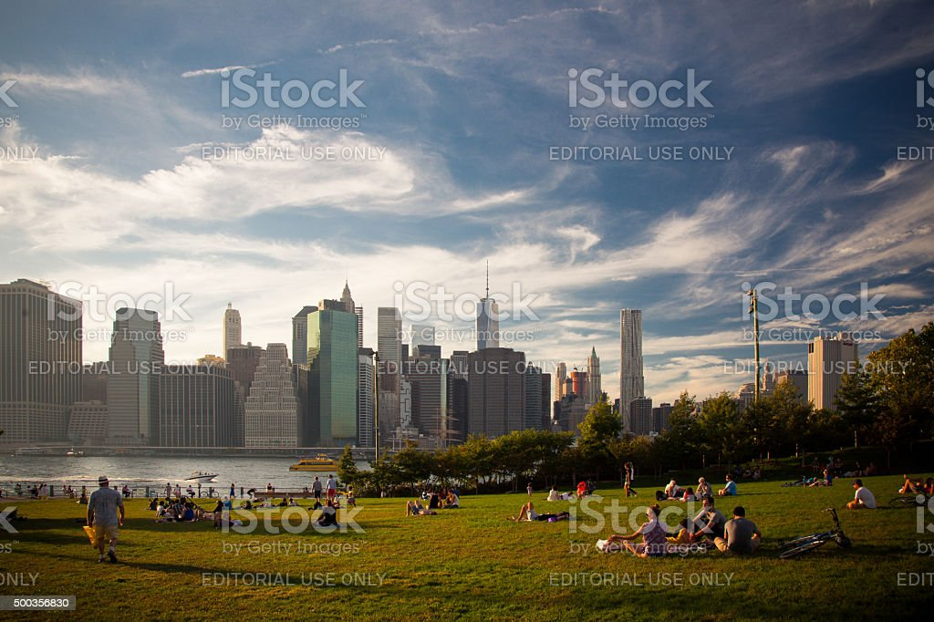 New Yorker enjoying the sunset at Brooklyn Bridge Park stock photo