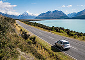Motion blur on a car on a summer journey in the Mount Cook National Park on New Zealand's South Island.