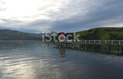 Amazing sunset light reflecting the sky in the Akaroa inlet in Southland New Zealand.