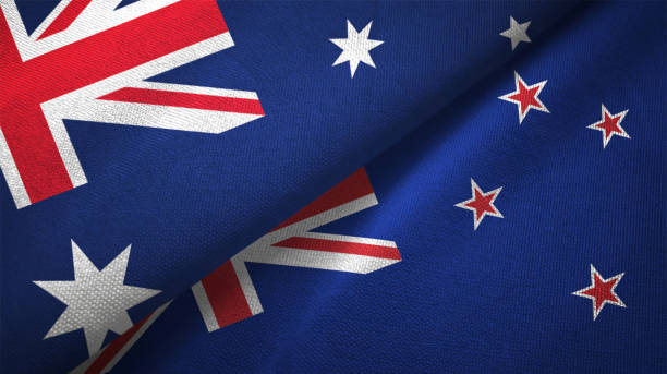 new zealand and australia two flags together realations textile cloth fabric texture - new zealand flag stock photos and pictures