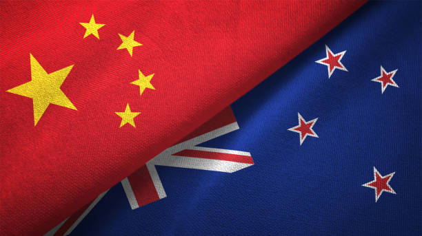 new zealand and china two flags together realations textile cloth fabric texture - new zealand flag stock photos and pictures